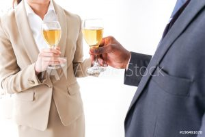 Businesspersons drinking alcohol image